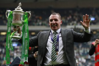 Celtic manager Brendan Rodgers celebrates winning the Scottish Cup Final with the trophy