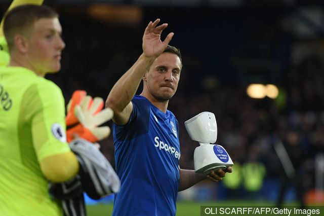 evertons_english_defender_phil_jagielka_holds_an_av1_telepresenc_765063